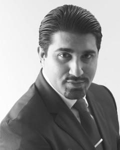 Talal-Malik-Official-Photo-Large-B-W-En 1